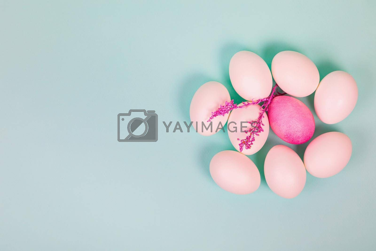 Easter. White eggs with a red egg and a twig on a uniform blue background. Place for text.
