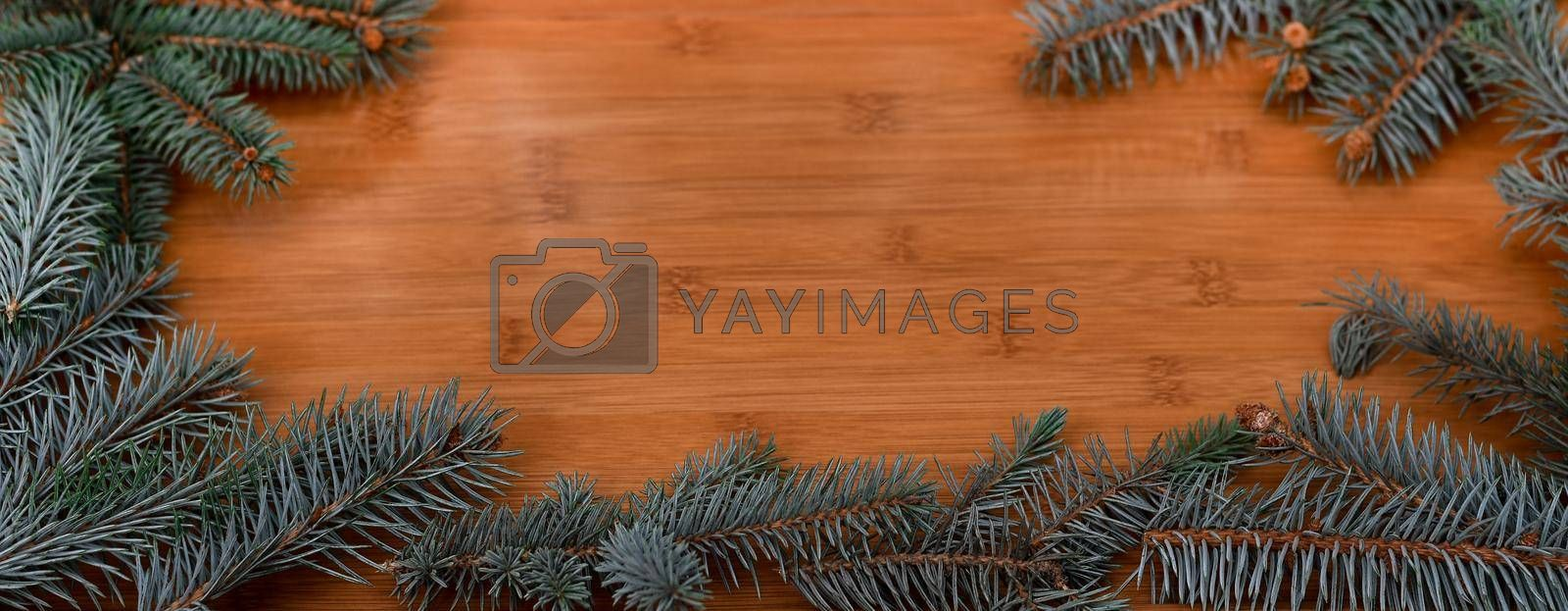 New year, Christmas. Spruce branches with free space in the center for your inscription. on wooden backgrounds. High quality photo