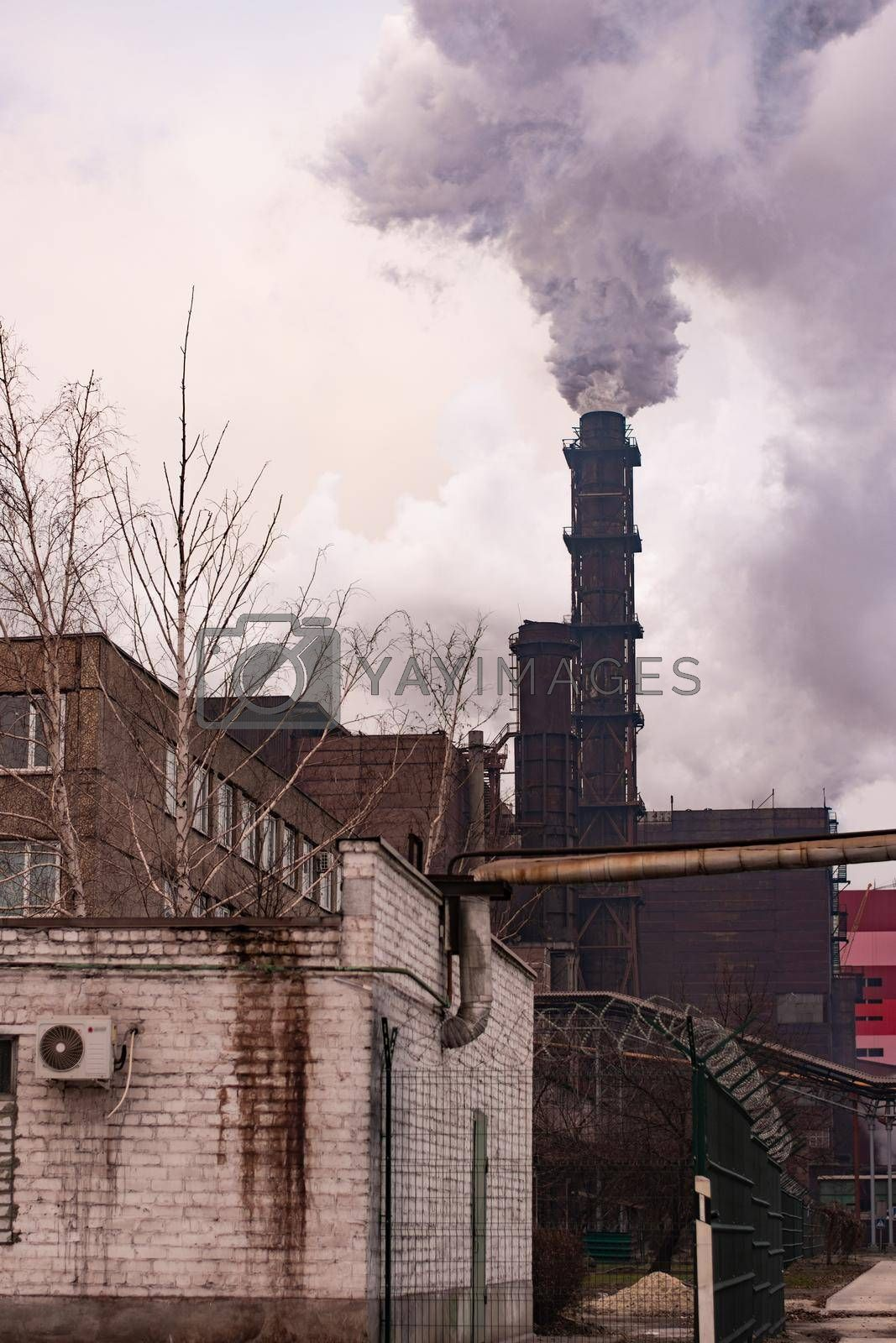 poor ecology. mining and processing of iron ore in Ukraine. Smoke emission.