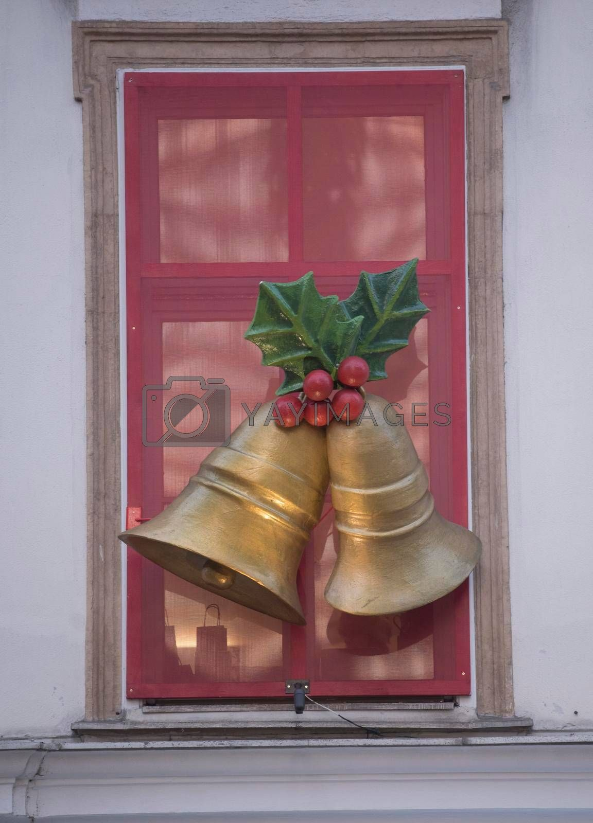 christmas bells and mistletoe in red window by Gubisch