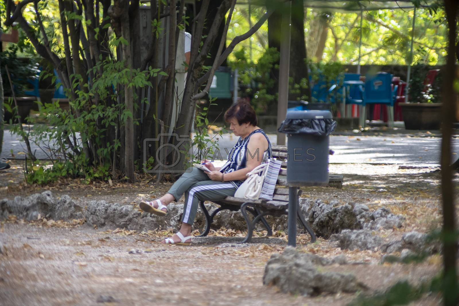 terni,italy august 16 2020:woman in the park alone cause covid 19