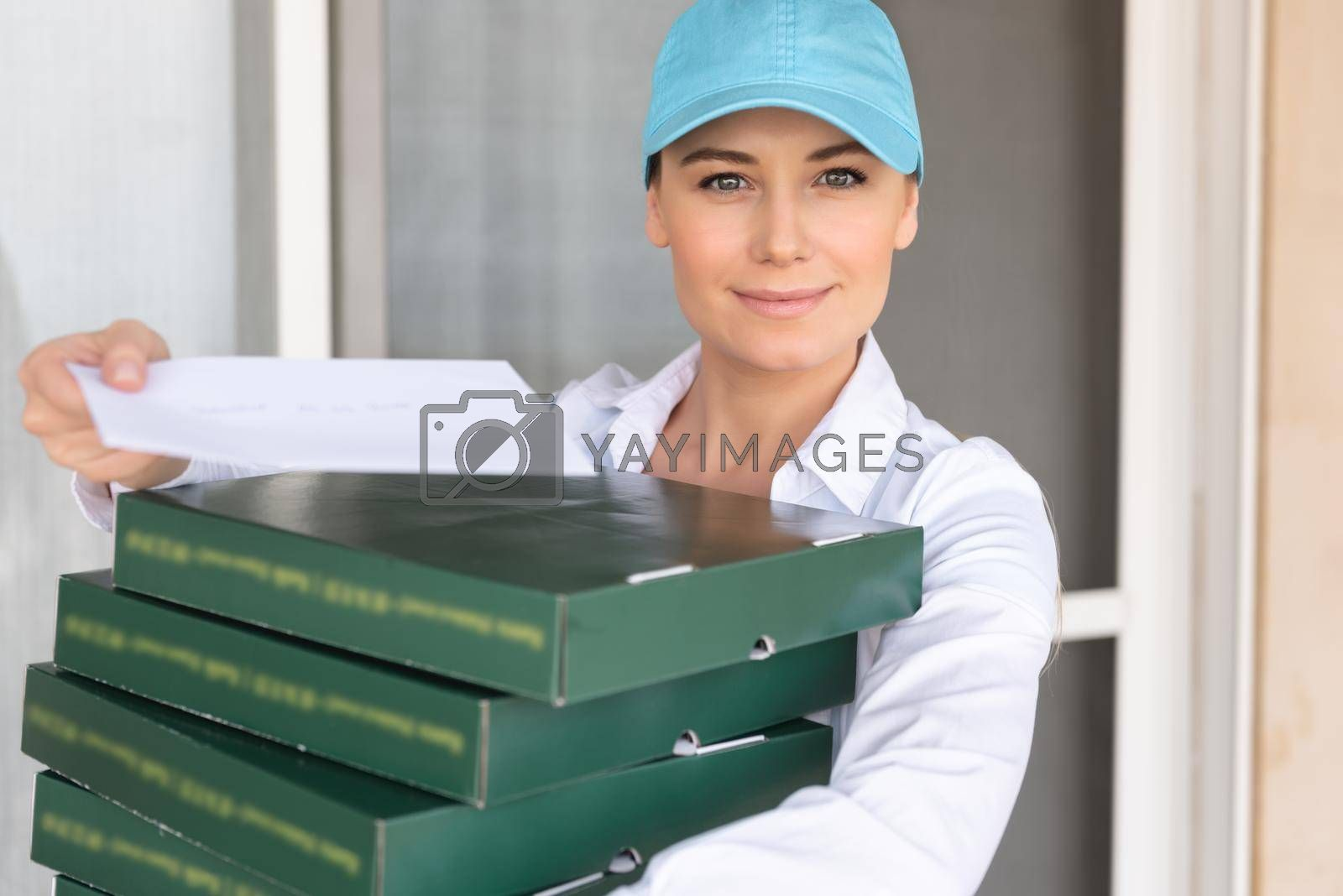 Portrait of a Pretty Girl Wearing Uniform Delivering Pizza to the Customer. Service Occupation. Fast Food. Food Delivery.