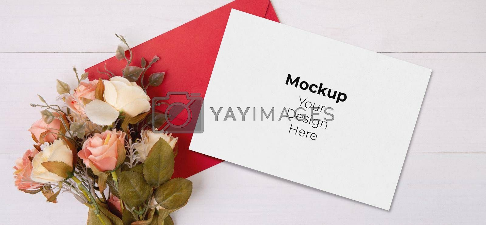 Royalty free image of Valentine day, greeting card mockup and letter and flower on wooden table, postcard blank and with romance on desk, present in anniversary and celebration, top view, holiday concept. by nnudoo