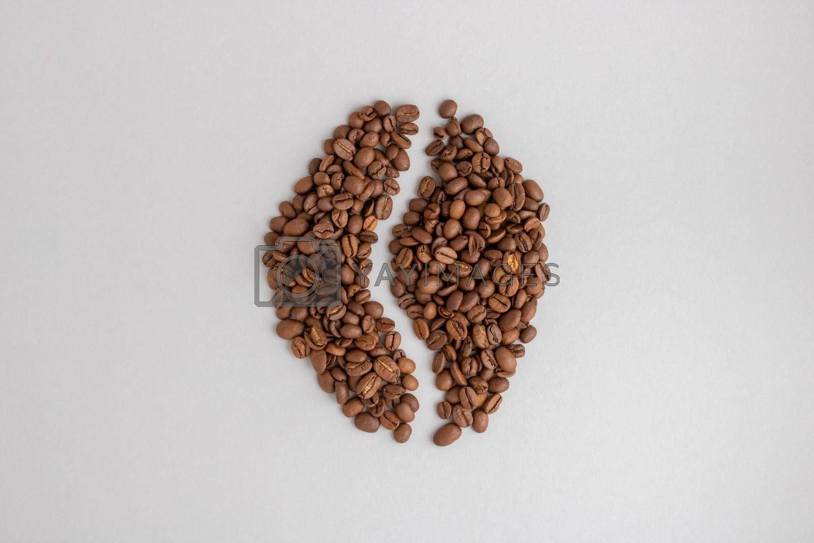 Coffee beans. Isolated on a gray background in the shape of a coffee bean.