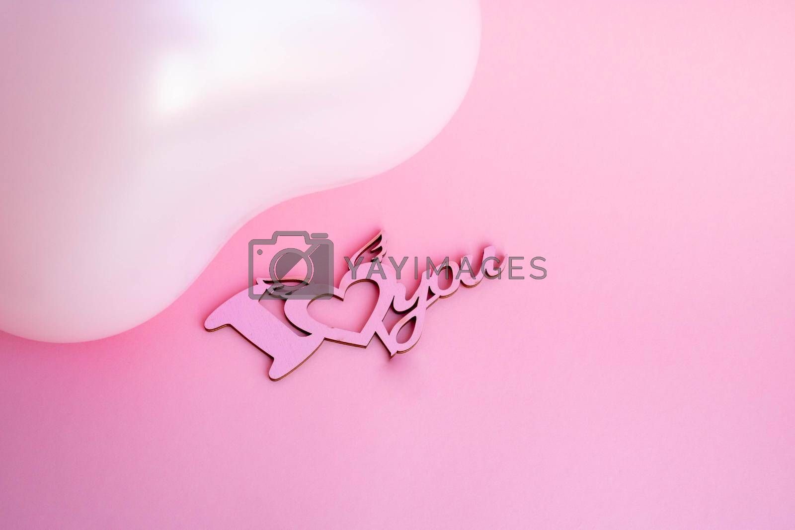 Pink balloon in the shape of a heart on a pink background, with a sign I love you. Wedding concept, Valentine's Day, photo zone, lovers. Banner. top view. Place for your text.