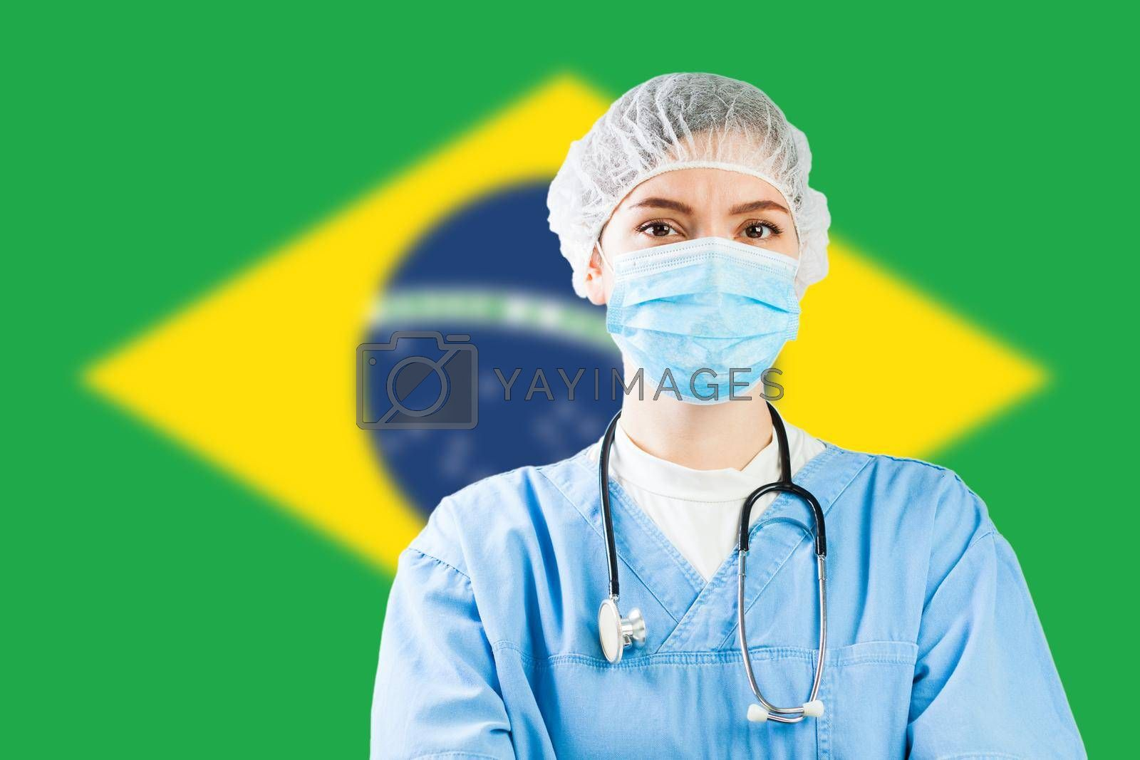 Portrait of a female doctor with flag of Brazil in background, COVID-19 virus disease crisis, Coronavirus global worldwide pandemic, social distancing isolation and quarantine concept