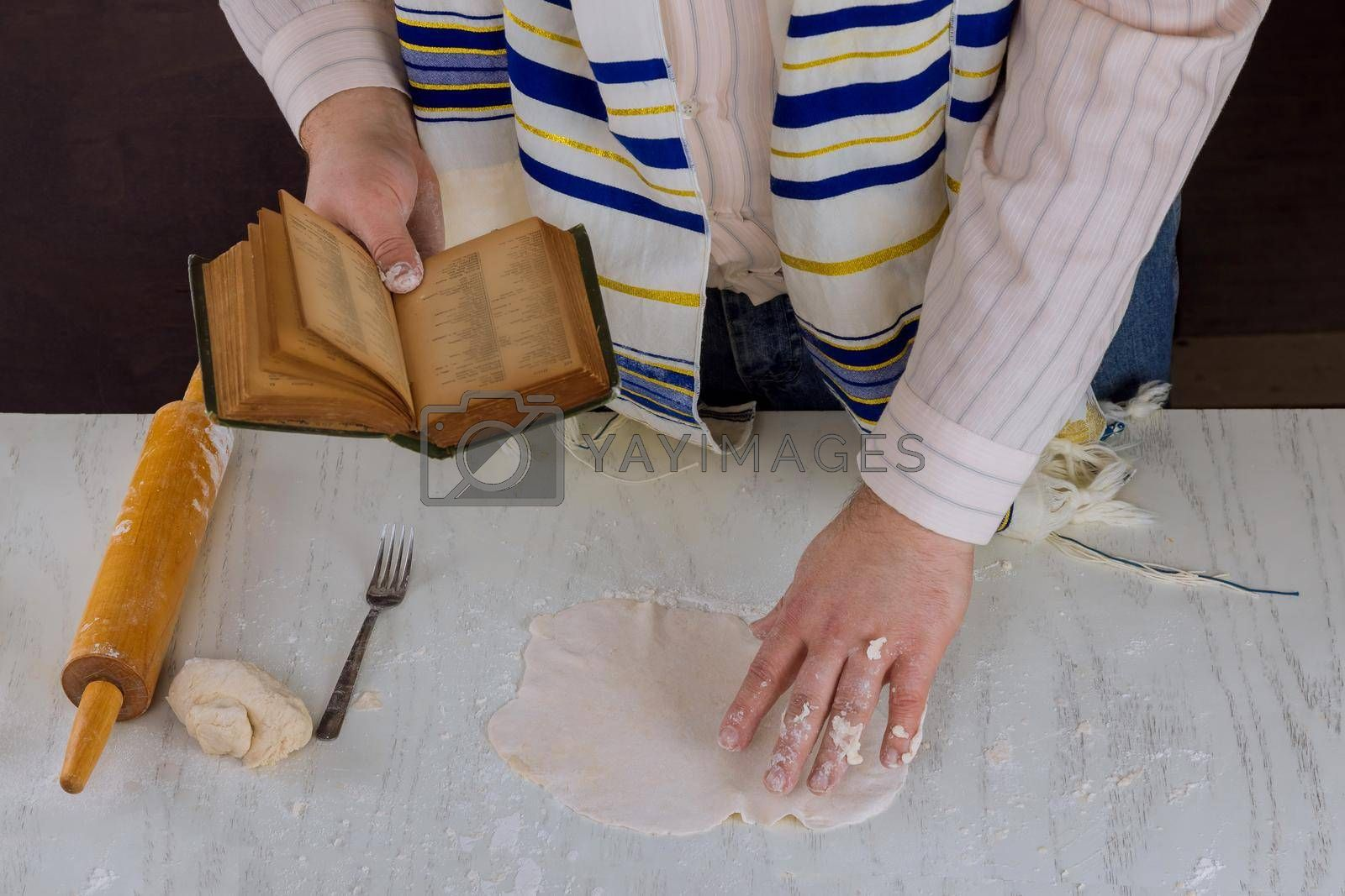 Jewish festival of Pesach with prayer during the preparation of kosher blessing matzah