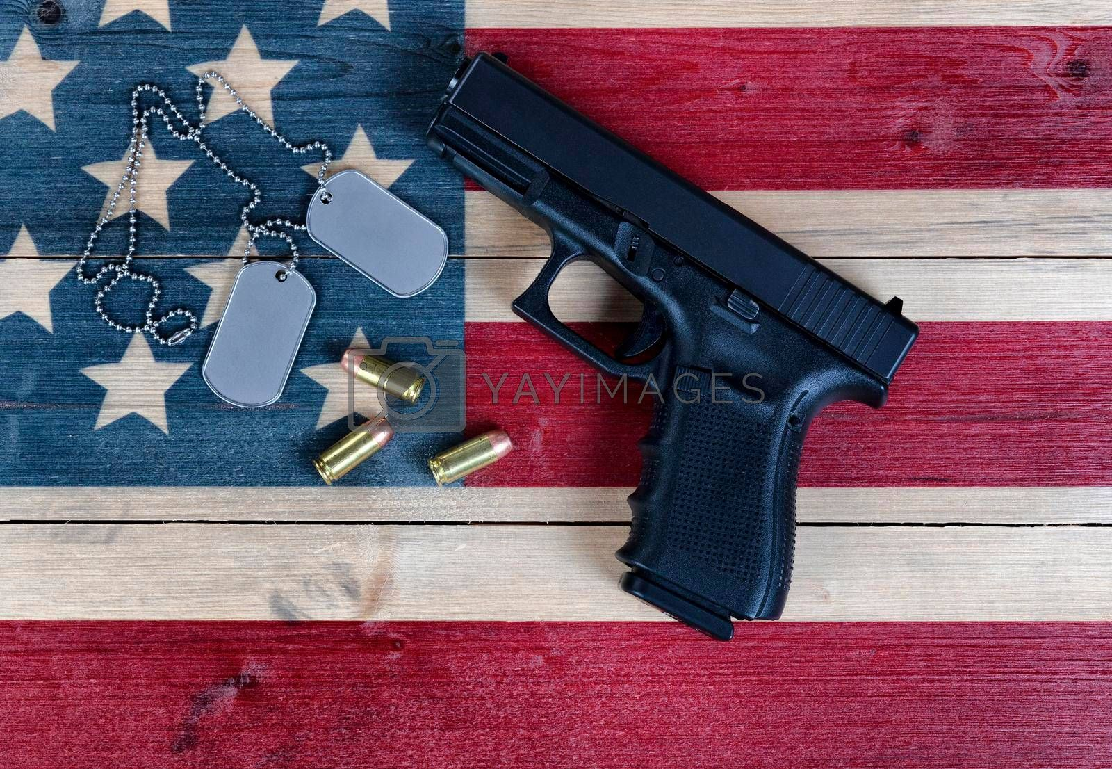Close of military items for Memorial, 4th of July and Veterans Day holiday on rustic US wooden flag