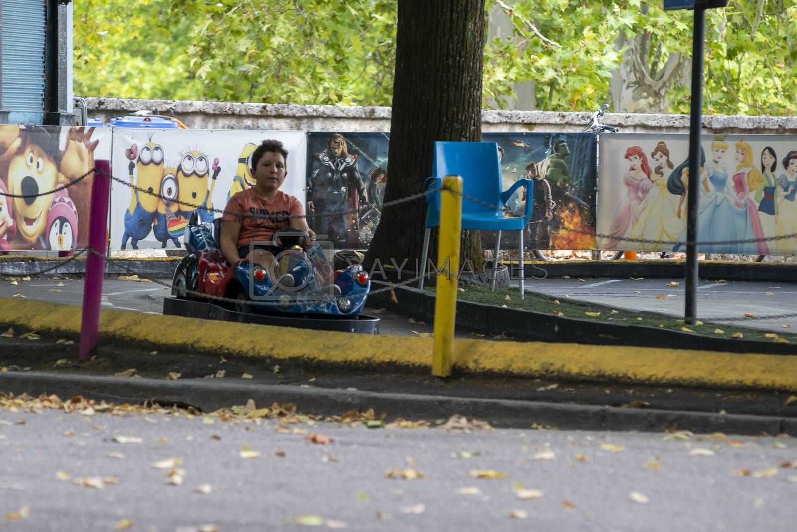 terni,italy august 16 2020:child at the park going on the electric car track