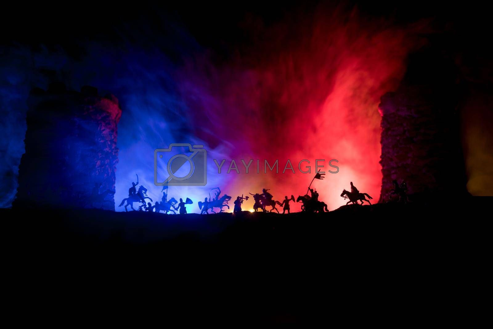 Medieval battle scene. Silhouettes of figures as separate objects, fight between warriors at night. Creative artwork decoration. Foggy background. by Zeferli