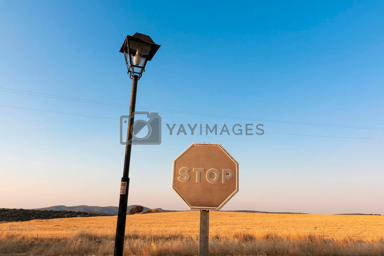 Sun-faded stop sign in southern spain