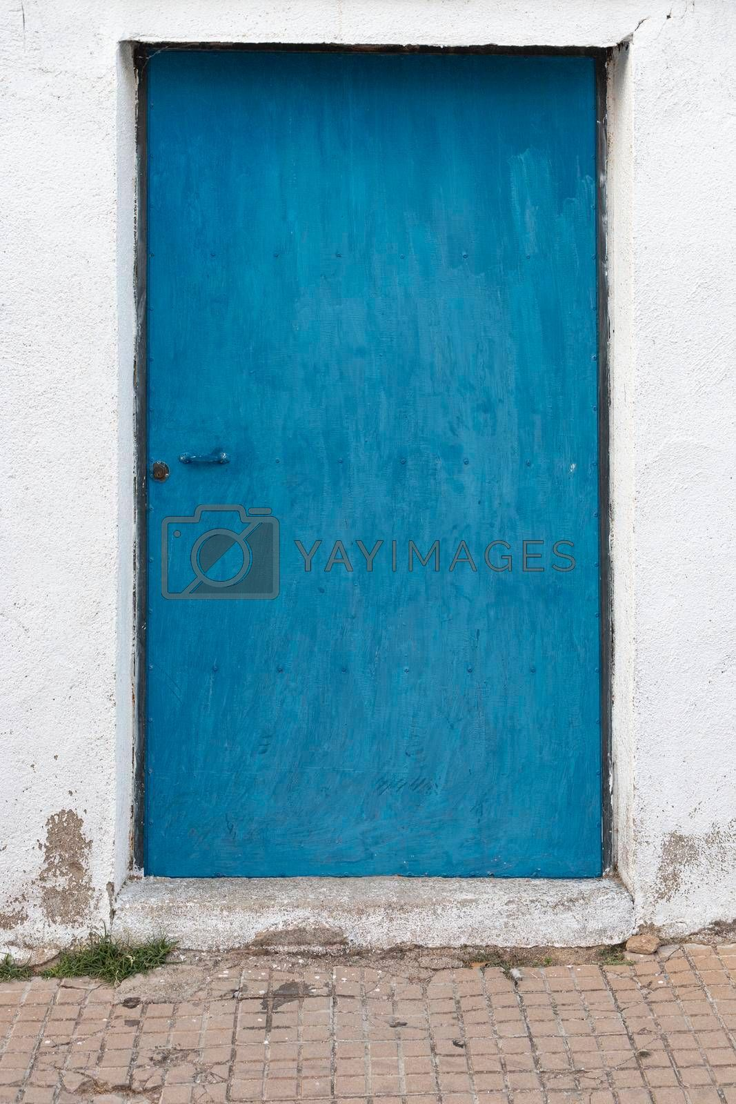 Blue painted door in southern Andalusia in spain