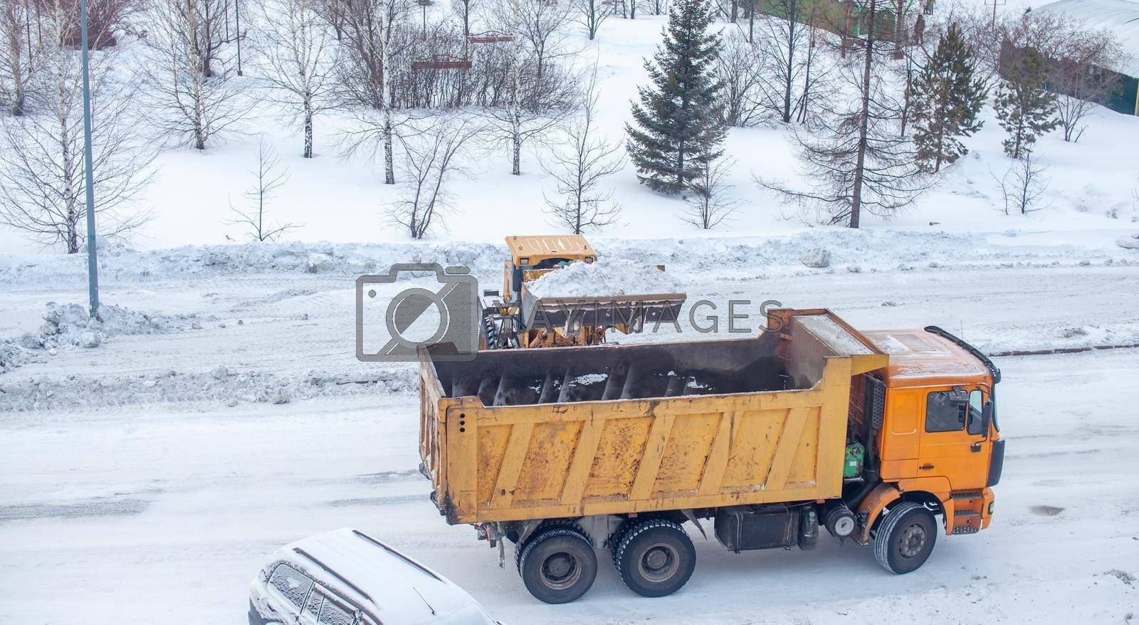 Cleaning and cleaning of roads in the city from snow in winter by AnatoliiFoto