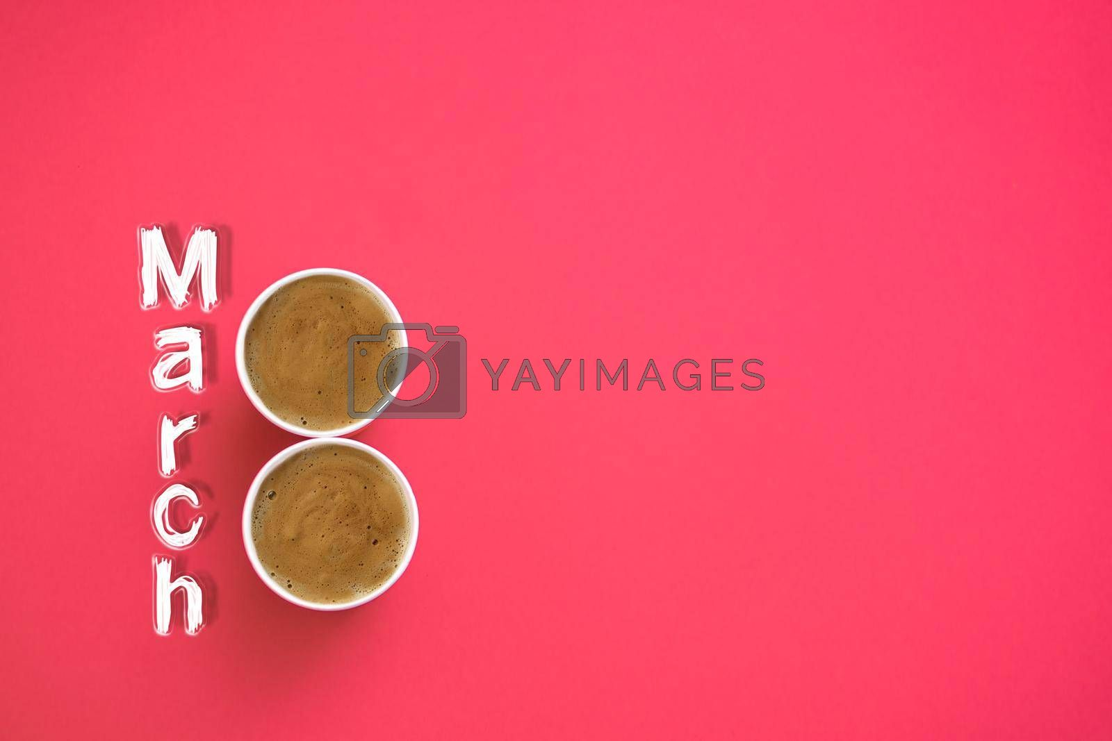 Two paper cups of morning coffee in the shape of the number 8. On a red background. The inscription is March 8. layout. copy space by ja-aljona