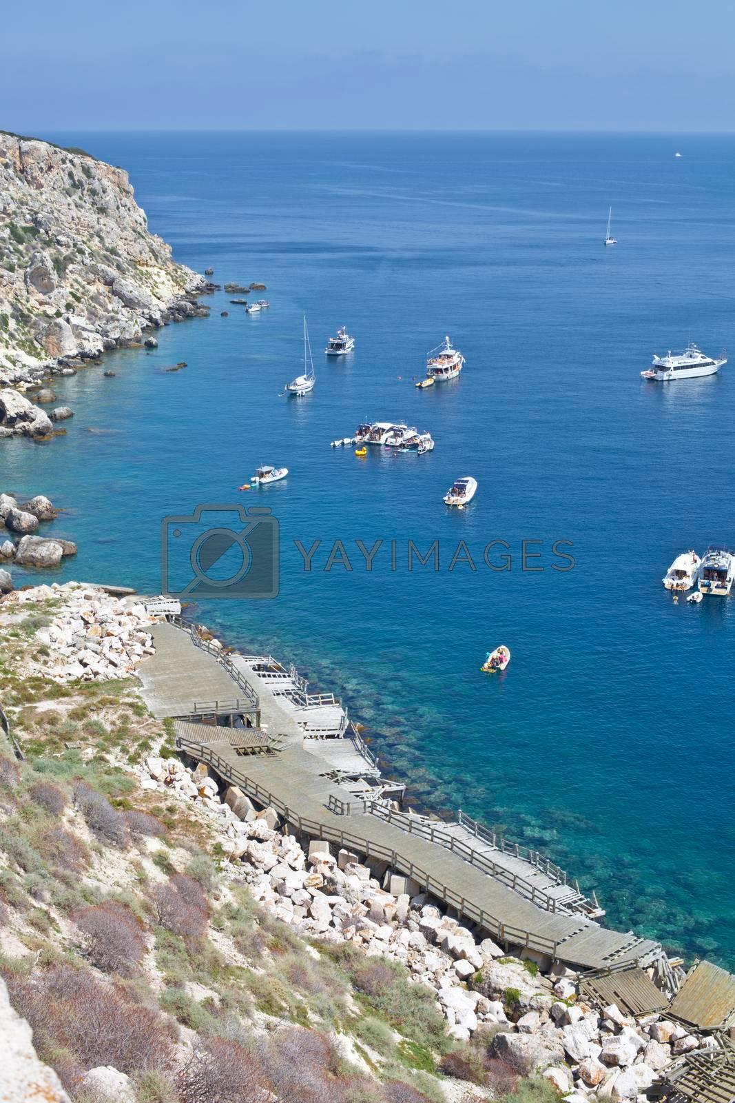 View of the Tremiti Islands. Boats near a rock stone coast. San Domino island, Italy: scenic view of tipycal rocky coastline. Adriatic Sea. Puglia, Italy.