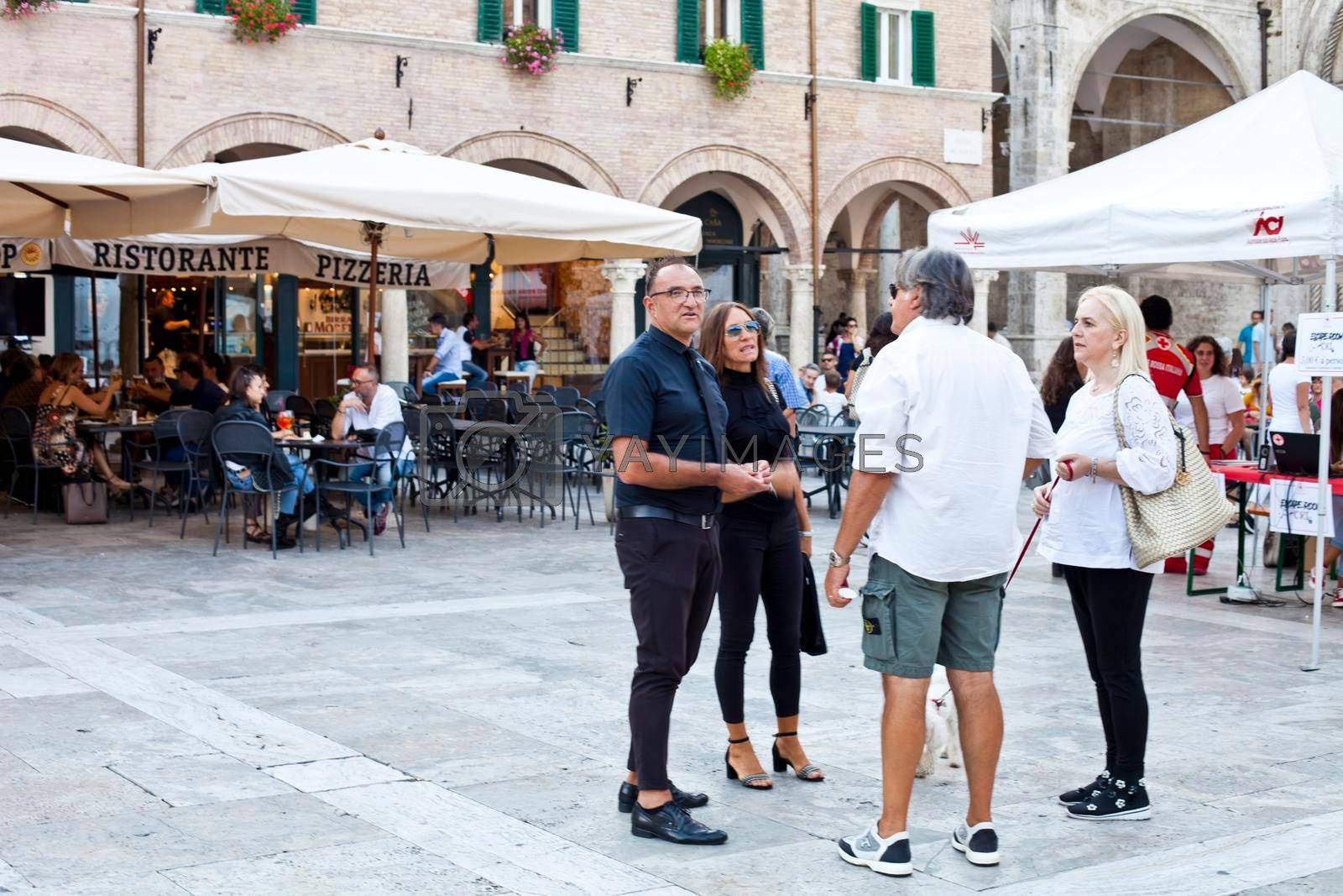 Ascoli Piceno, Italy - September 9, 2019: People enjoying happy day and food at outdoor restaurant and resting.