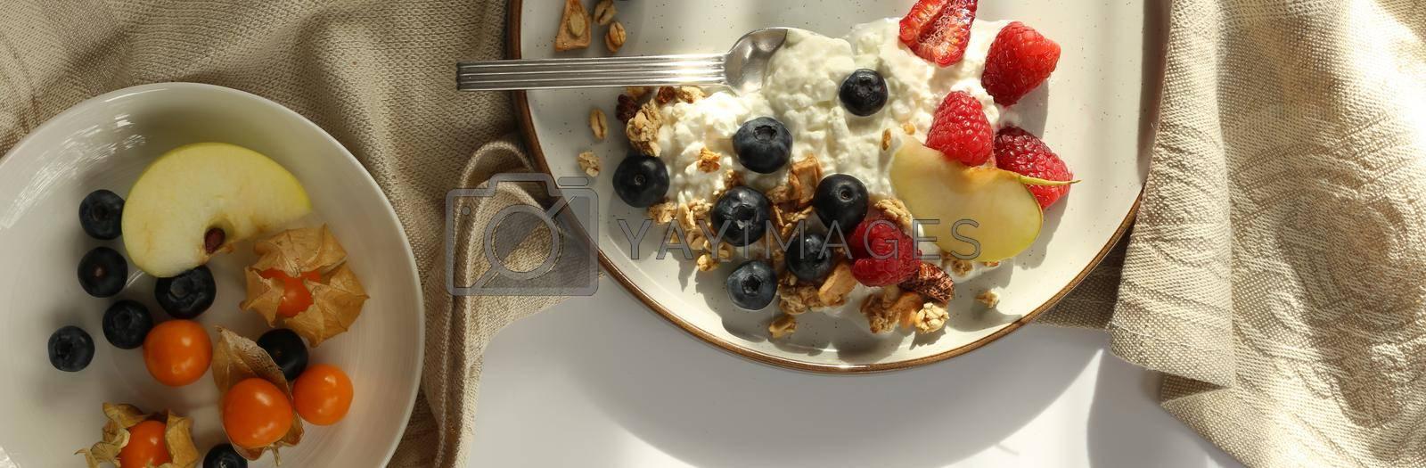 Healthy breakfast top view by NelliPolk