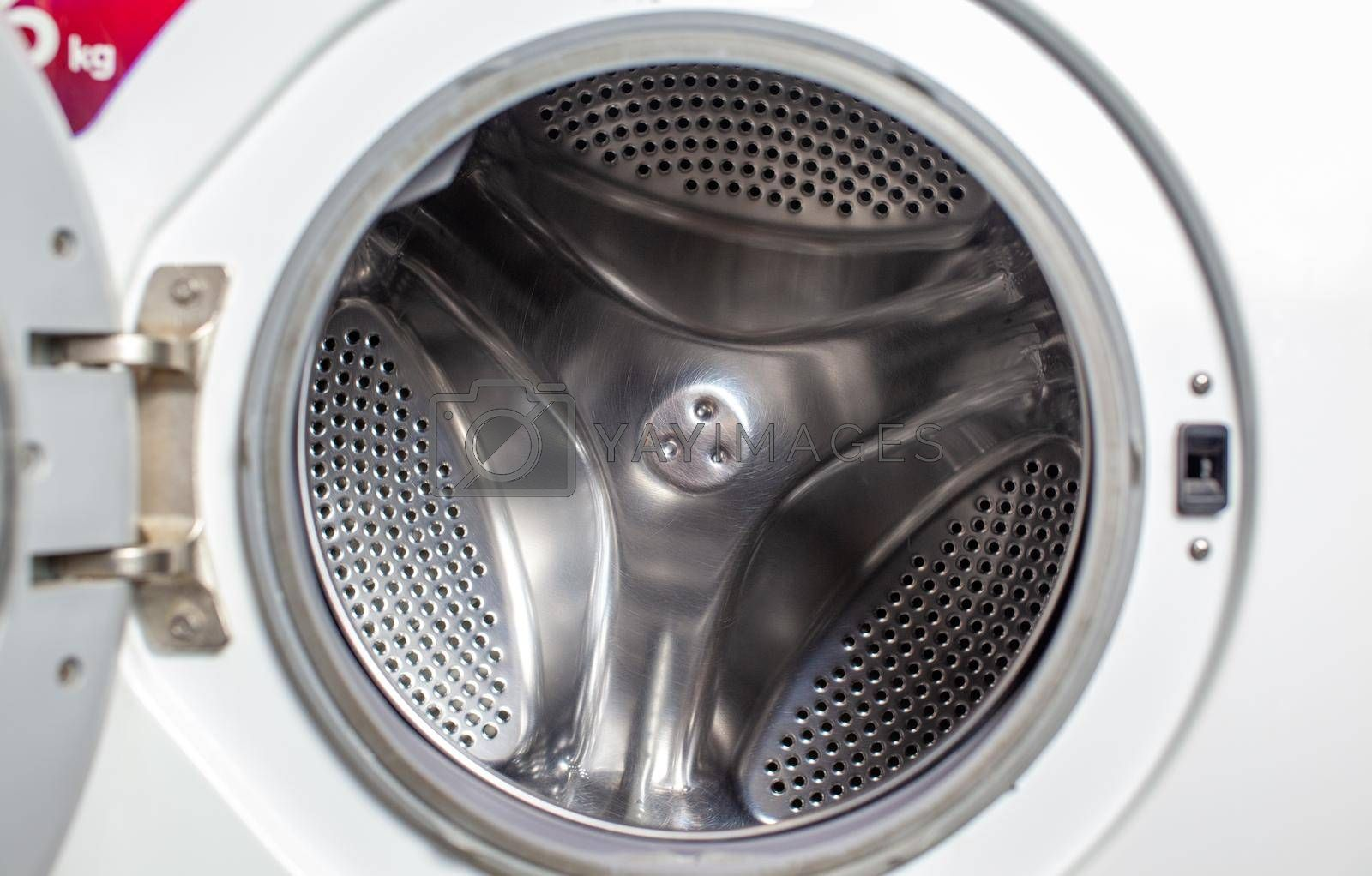 Drum of washing machine dry and clean close-up. Washing Dryer Machine inside view of a drum.