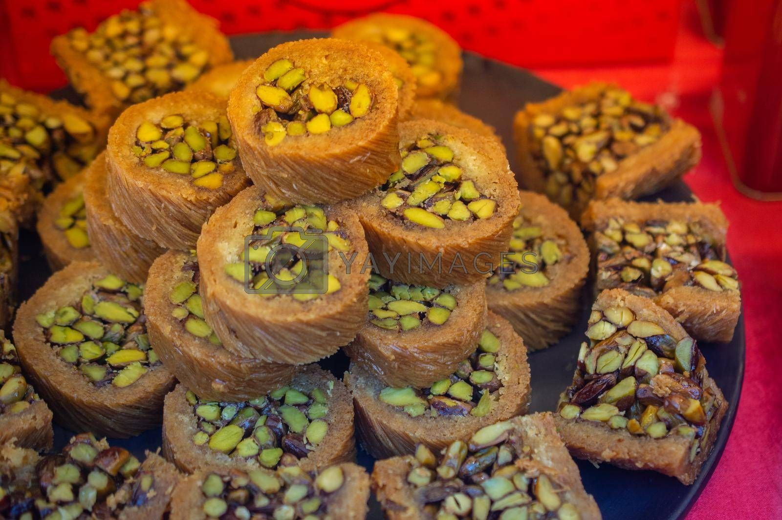 Turkish traditional dessert Kadayif  baked in syrup served with nut powder