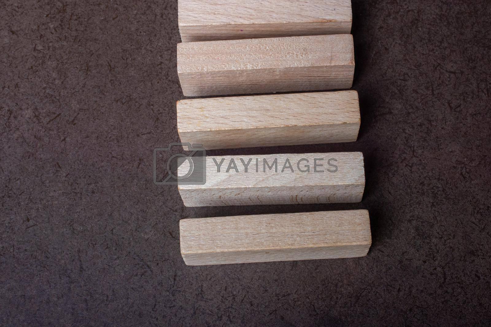 Wooden piece of domino wood on dark background