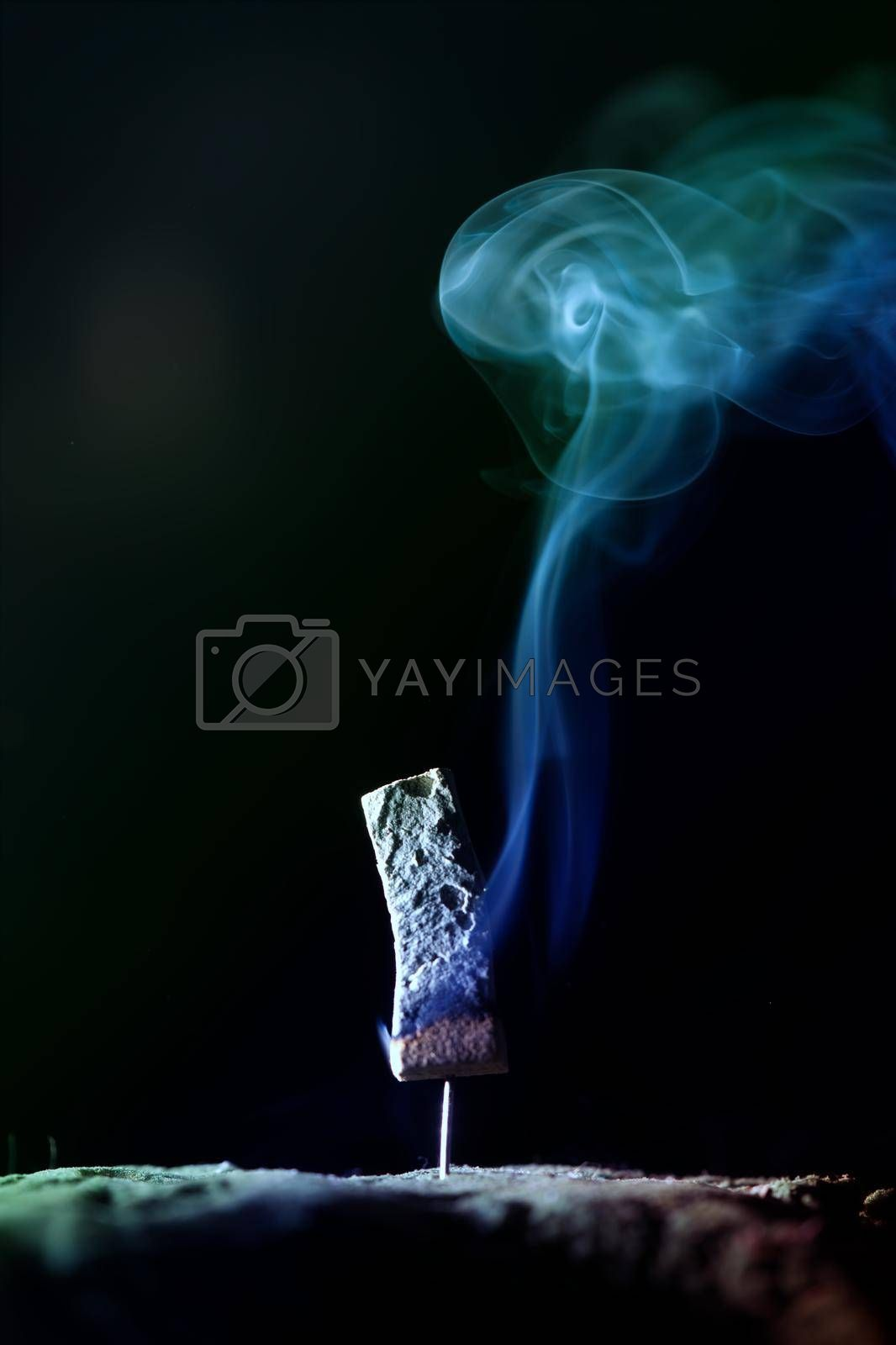 Incense burning incense, white smoke, black background, used as background image Paying homage to the sacred objects of the people of Buddhism according to their beliefs and beliefs.