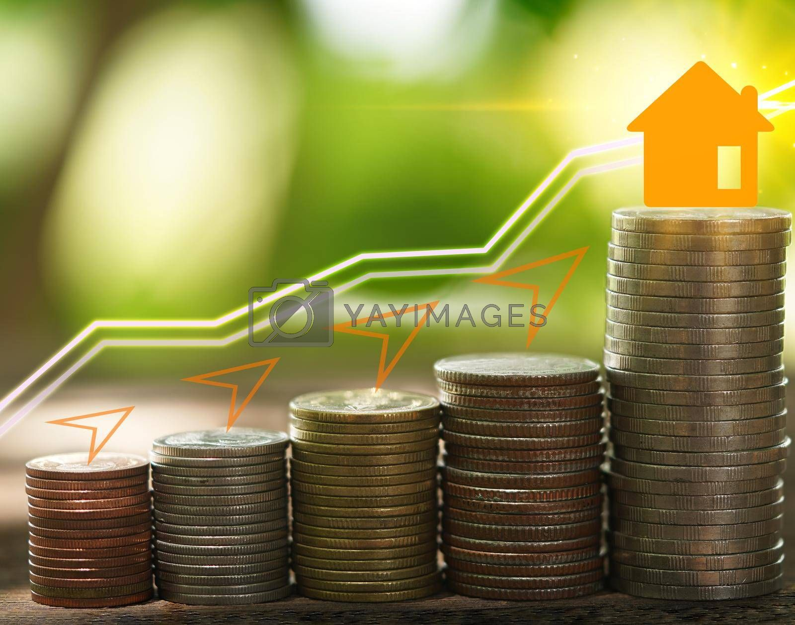 Stacked coins investment ideas saving money to build real estate.