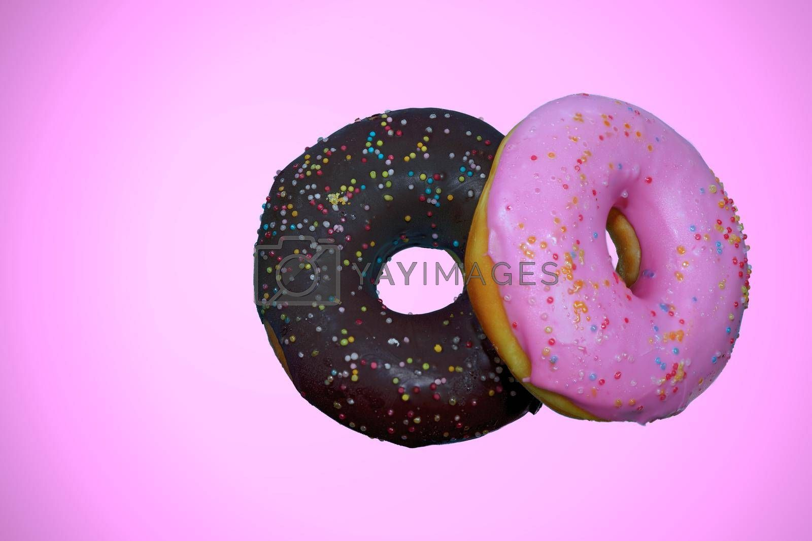 Pink Cream Donuts and Chocolate Donuts Pink background isolated.