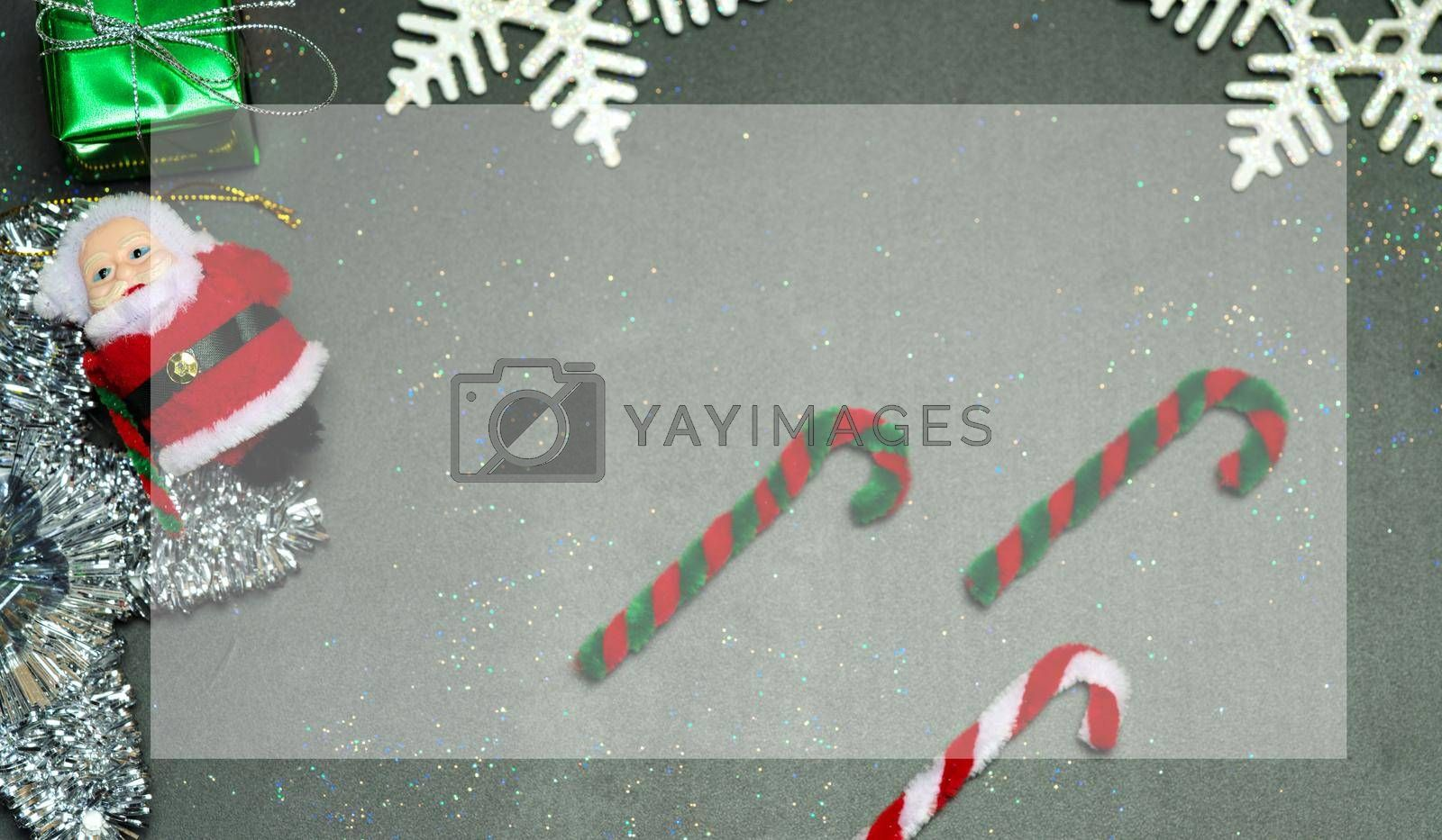 Elegant Christmas background copy space with golden snowflakes and bells with shining gift box, black wood texture background.