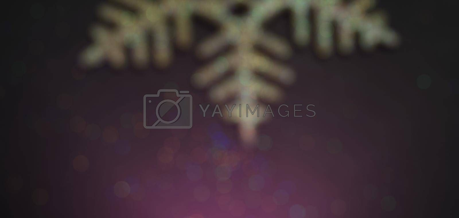 Blurred bokeh elegant christmas background with golden snowflakes shining black wood texture background.