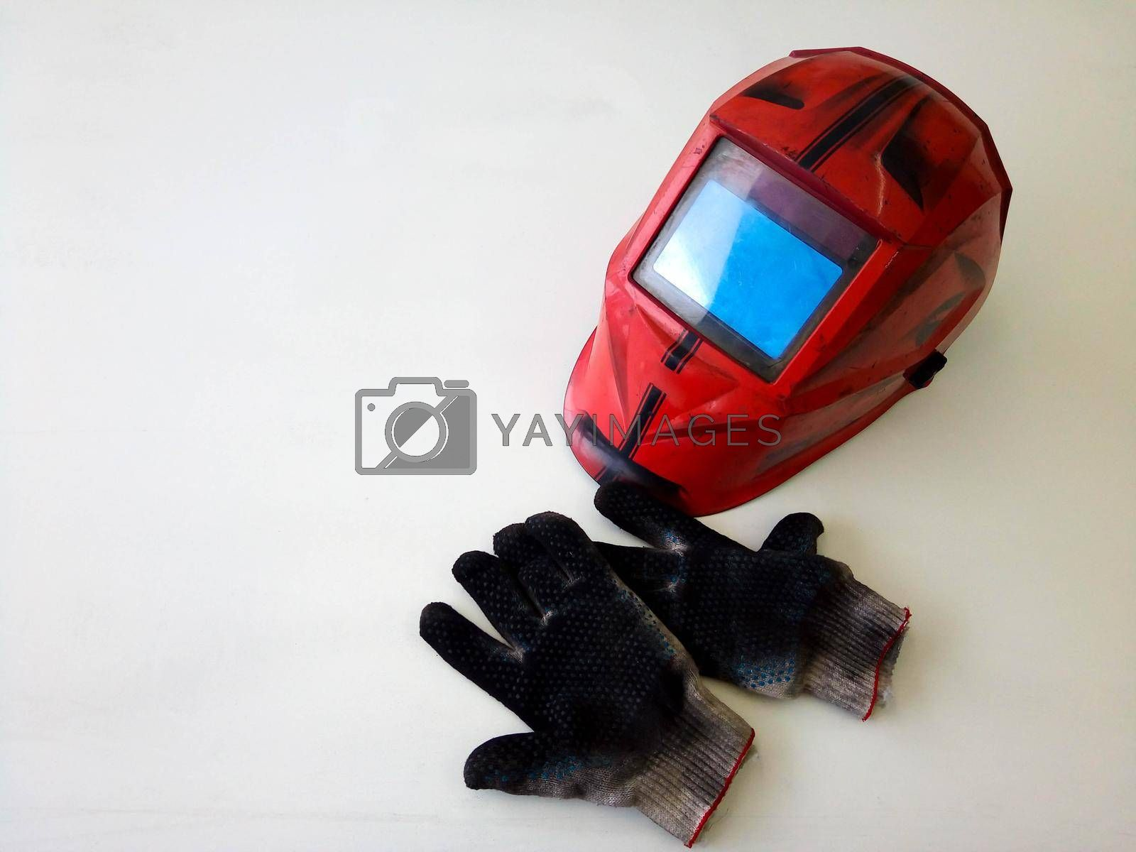 Photos of dirty welding gloves, welder's mask in the workshop