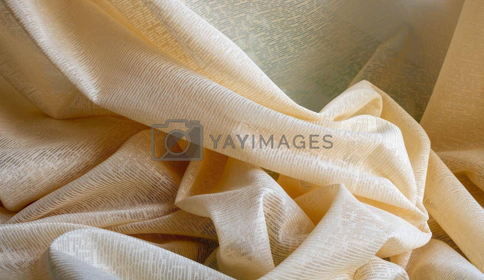 Beige tulle fabric background, seamless texture with beautiful close-up and elegant fabric background details. Luxury tulle textile pattern with soft vintage material. Space for your text. by lapushka62