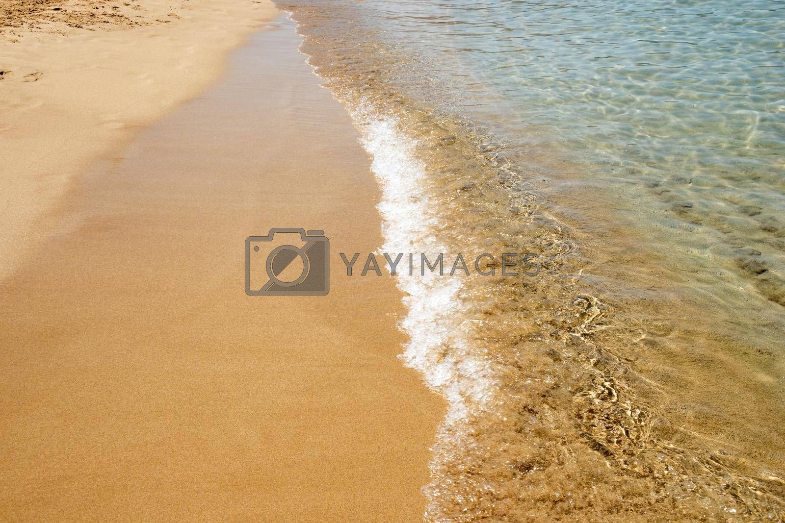 Mesmerizing shot of soft waves on a sandy beach