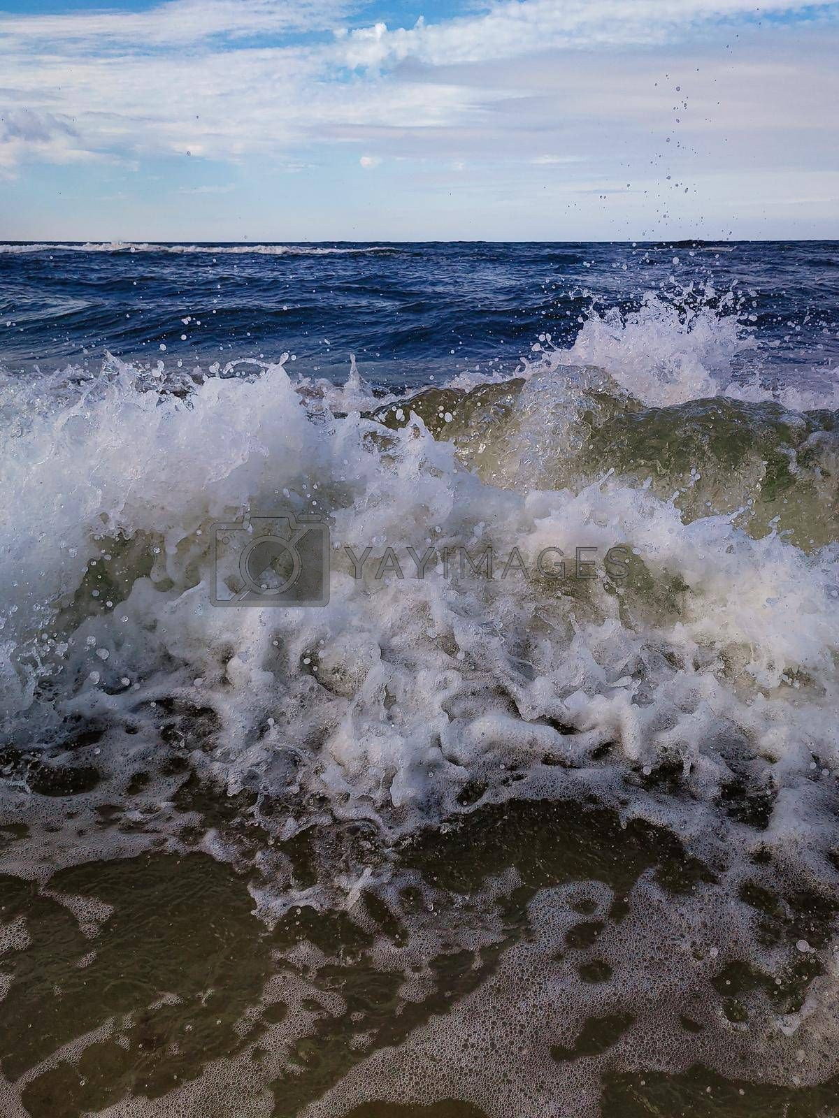 Mesmerizing view of a wave splashing on the Baltic sea
