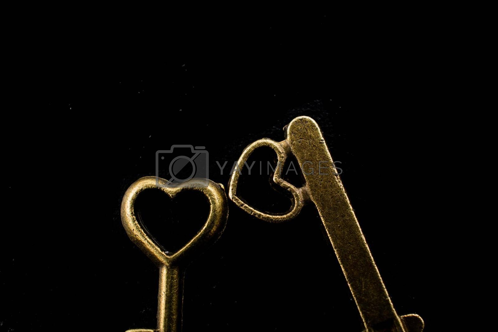 Heart shaped retro metal keys on dark background