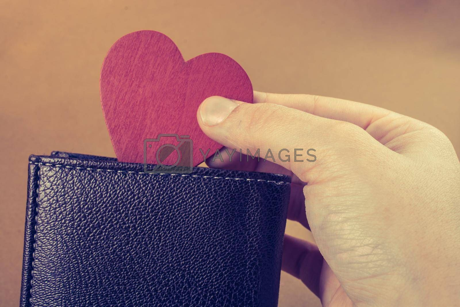 Brown leather wallet in hand  saving and finance concept