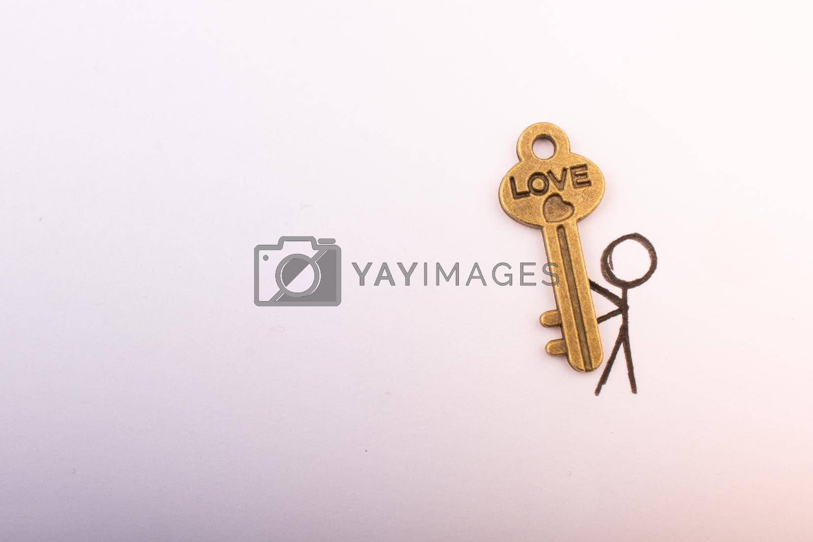 Royalty free image of Man carrying a  retro style heart shaped key as love concept by berkay