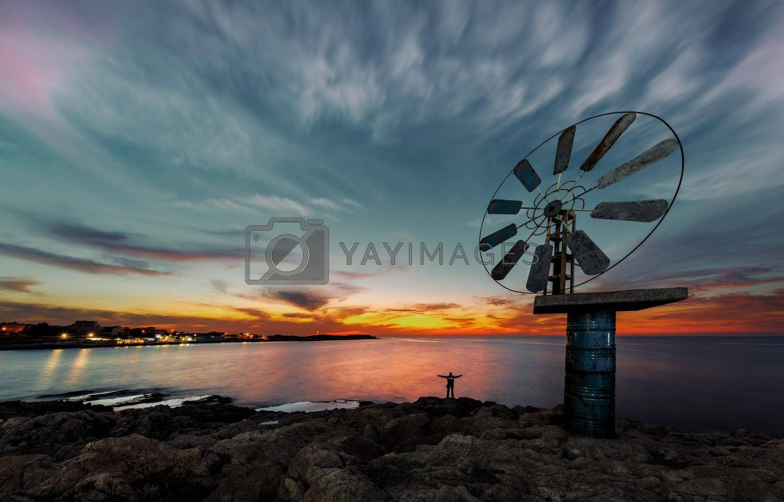 Beautiful View on a Great Windmill over Sunset Sky Background on the Sea Coast. Anfeh. Lebanon