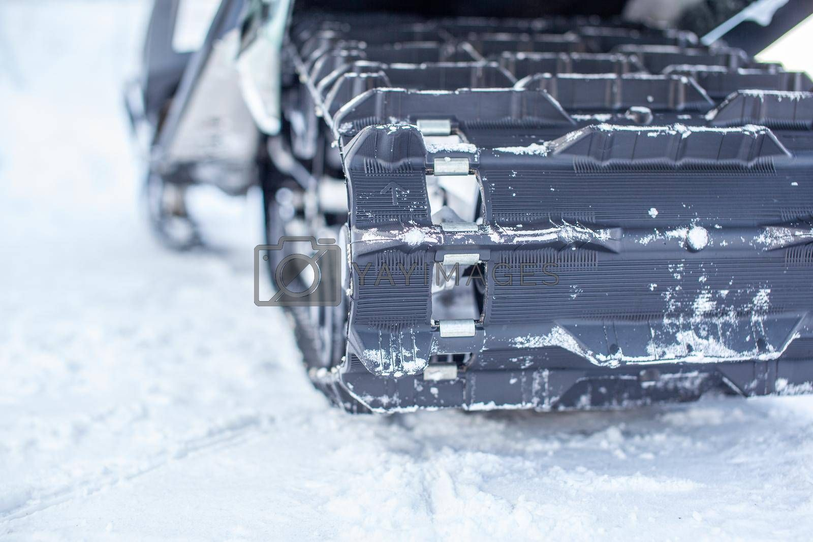 The back of the snowmobile in winter. Riding in the snow on a snowmobile. Rear suspension of a snowmobile
