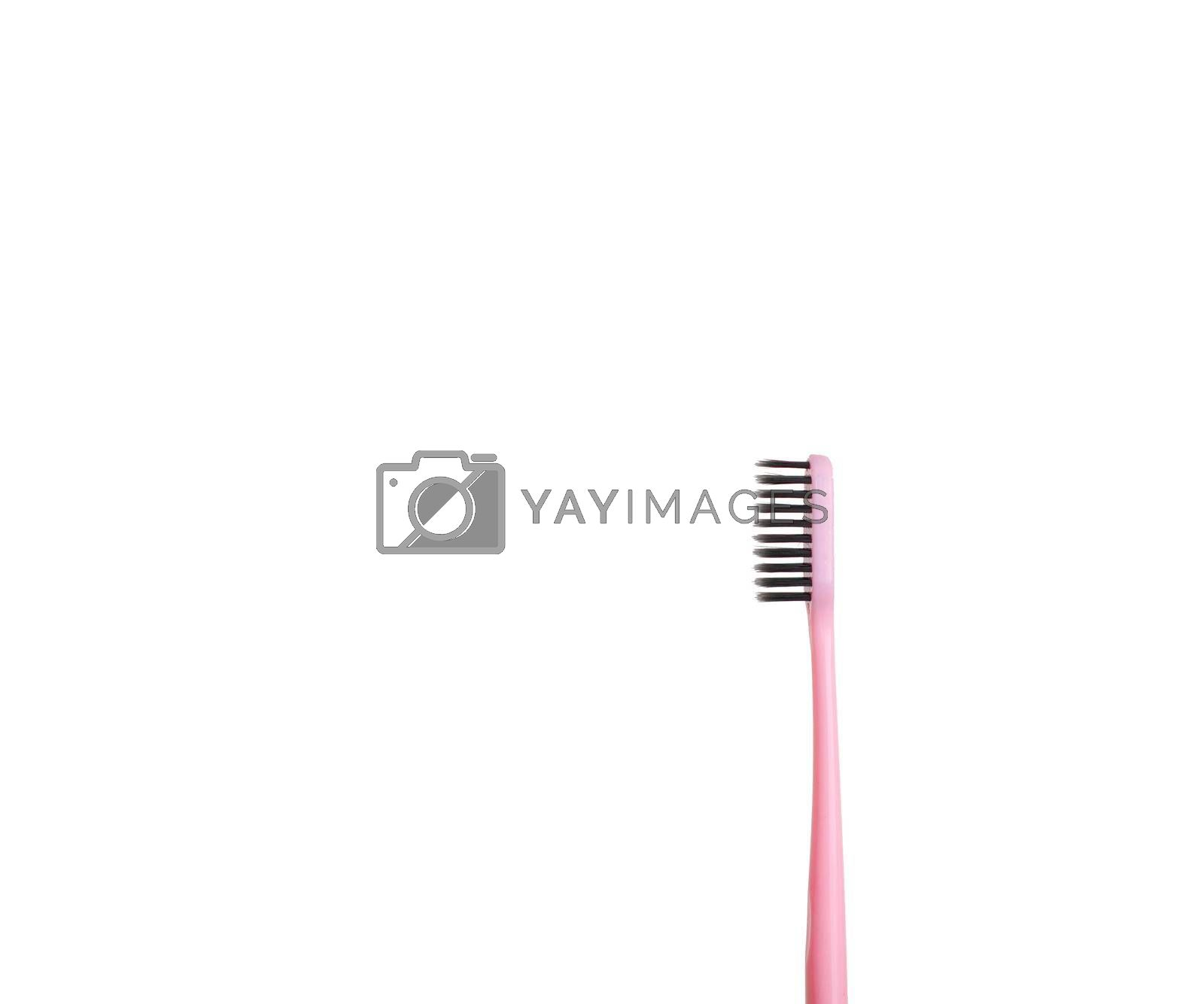 The pink tooth brushing cheek is isolated on a white background. Care and hygiene for the oral cavity