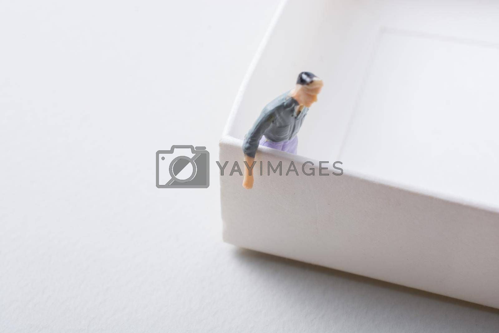 Tiny figurine of man miniature model in view