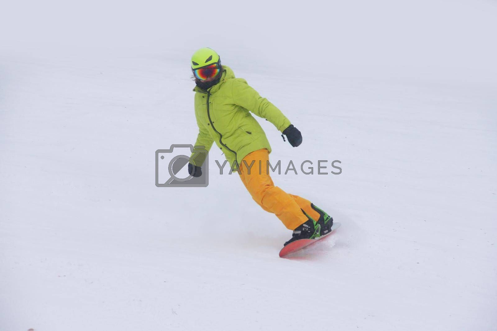Woman snowboarder on the slopes frosty winter day. Girl on snowboard in the snow