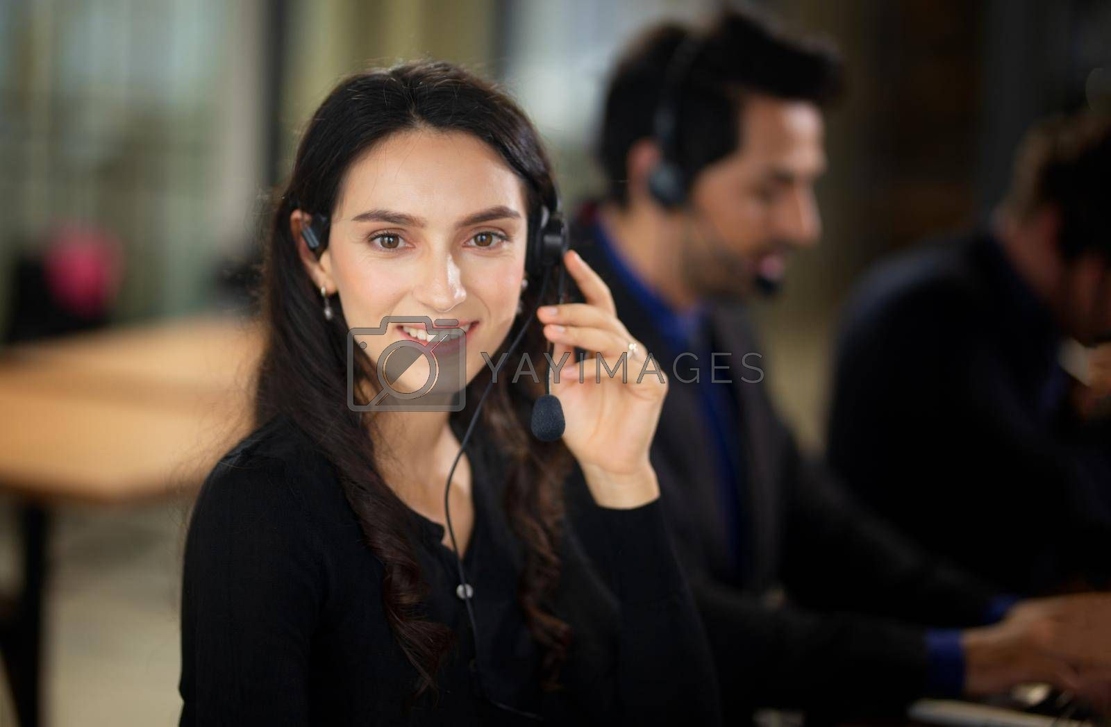 Royalty free image of Colleagues working in a call center. by chuanchai
