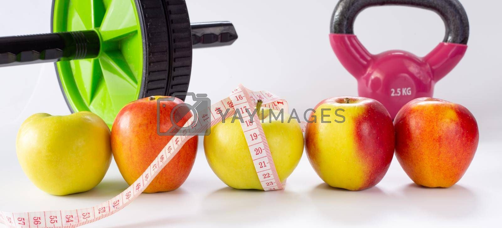 healthy life fitness. Diet and Healthy life Concept. Apples, measure tape, sport home gym equipment kettle bell, ab roller for women diet slimming