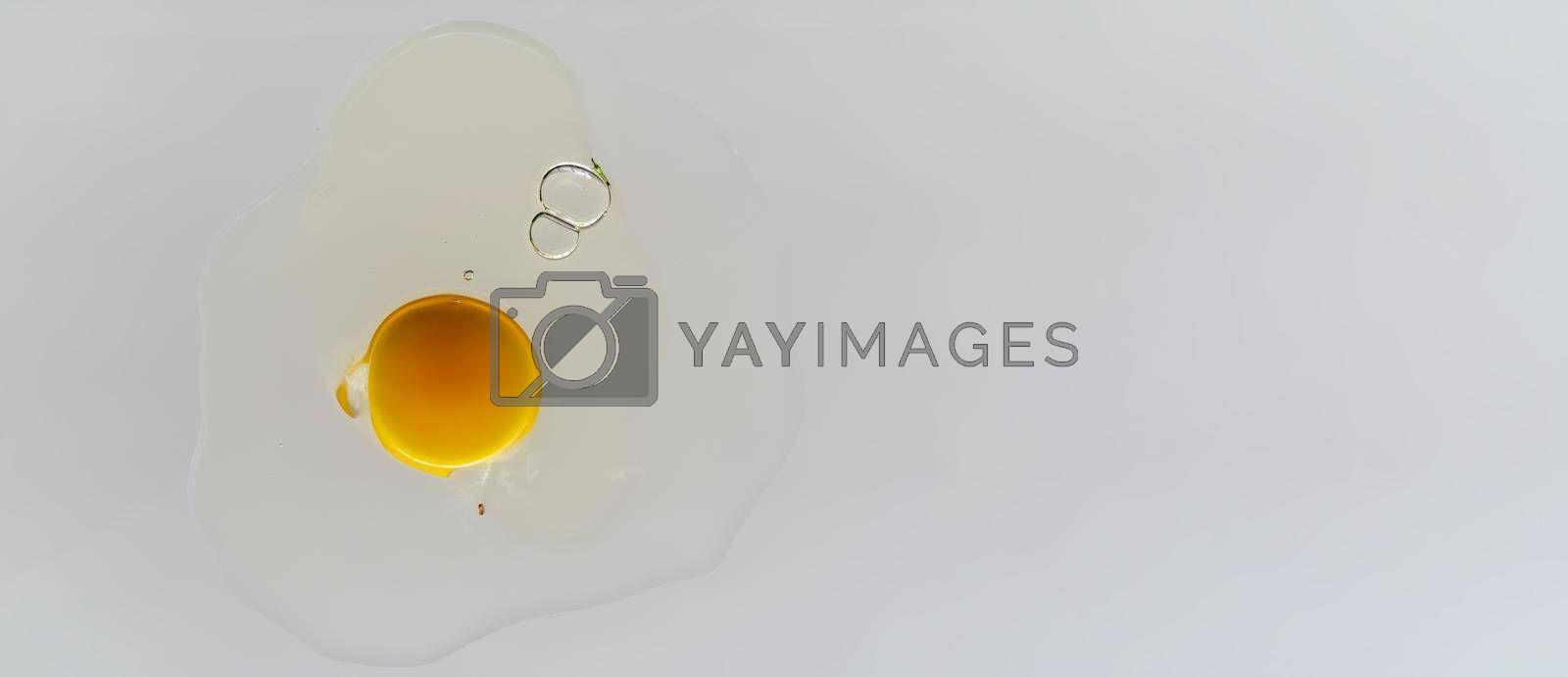Royalty free image of Cracked chicken egg on transparent surface. by maramade