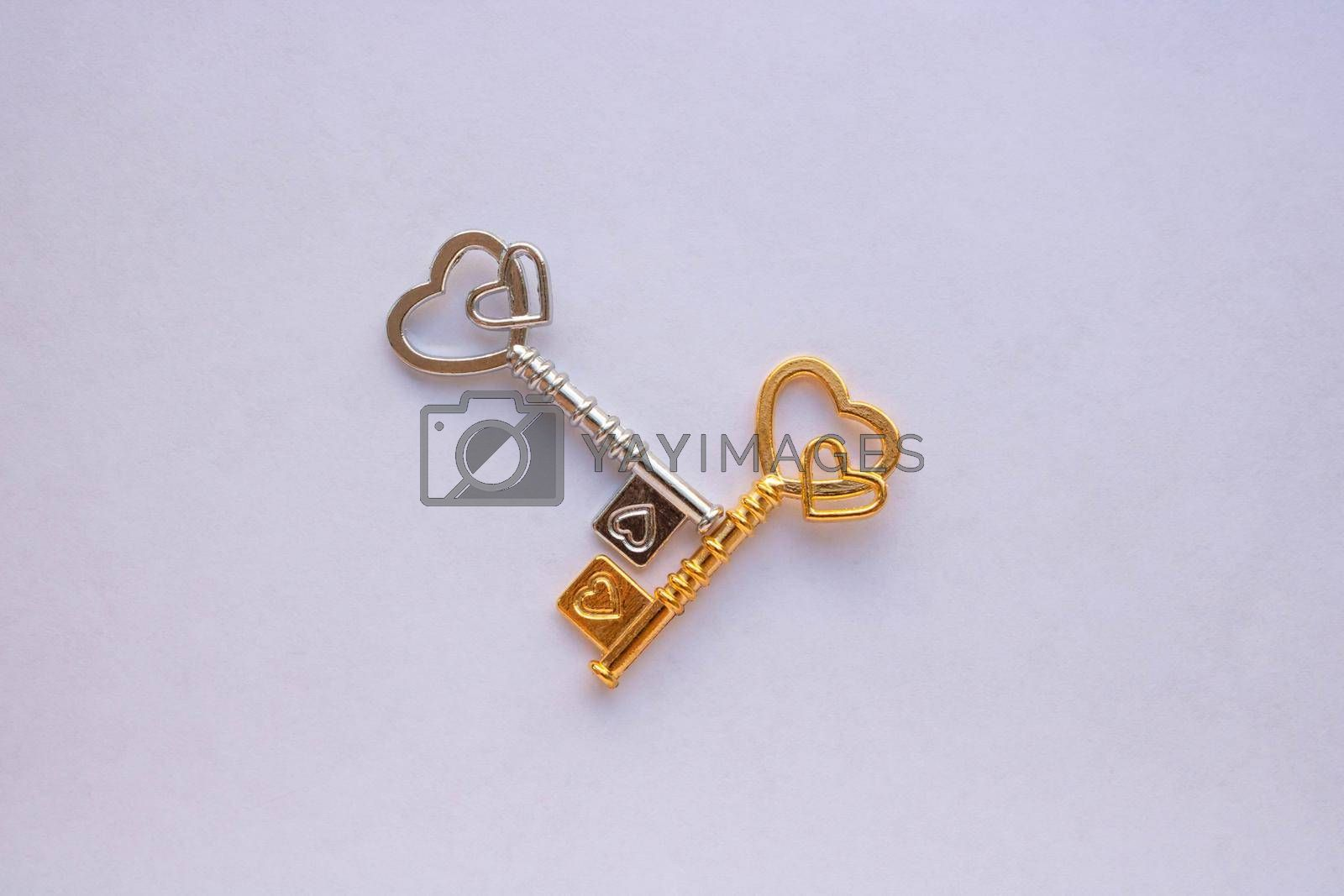 Gold and silver keys isolated on a white background.