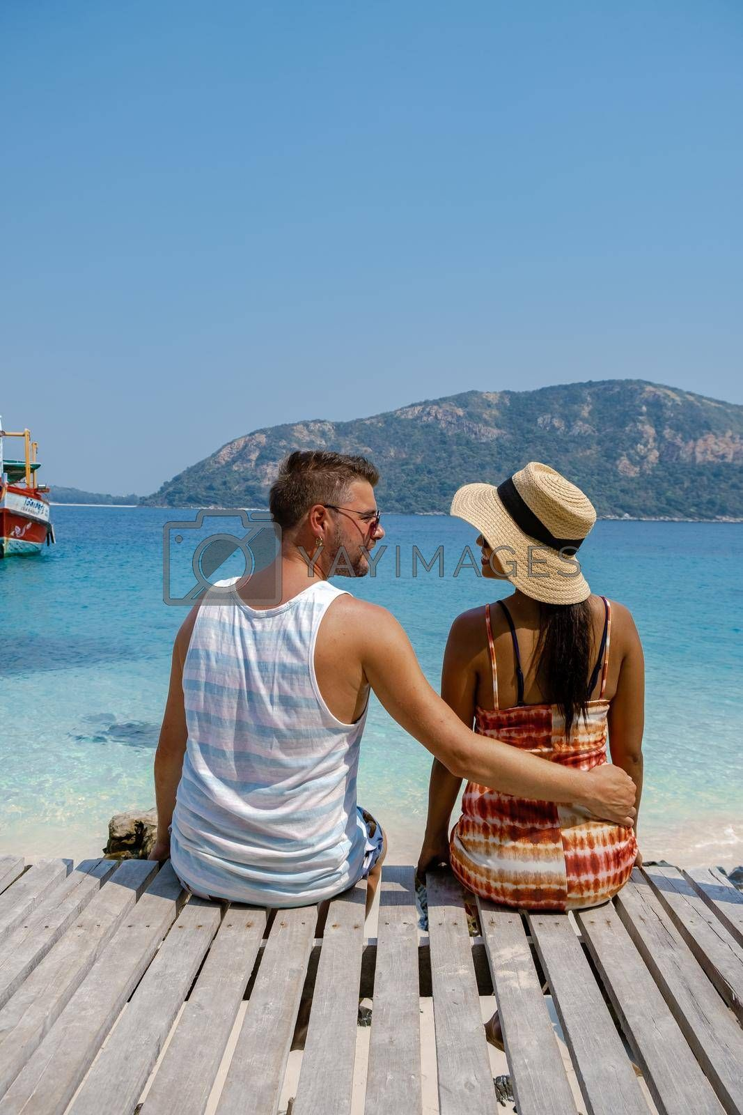 Royalty free image of Couple from behind on the backside looking out over ocean of tropical Island, beautiful tropical island beach - Koh Kham, Trat Thailand Pattaya Asia, couple relax on tropical Island by fokkebok