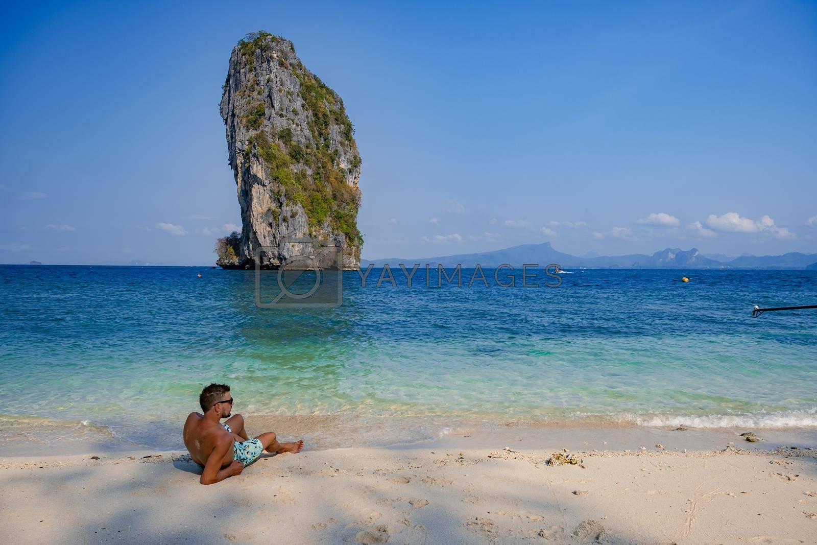 Koh Poda Island Thailand, couple mid age Asian woman and European man on the beach, Koh Poda Thailand, beautiful tropical beach of Koh Poda, Poda Island in Krabi province of Thailand South East Asian