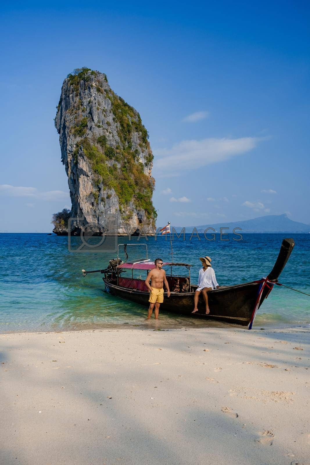 Royalty free image of Koh Poda Island Thailand, couple mid age Asian woman and European man on the beach, Koh Poda Thailand, The beautiful tropical beach of Koh Poda or Poda Island in Krabi province of Thailand.  by fokkebok