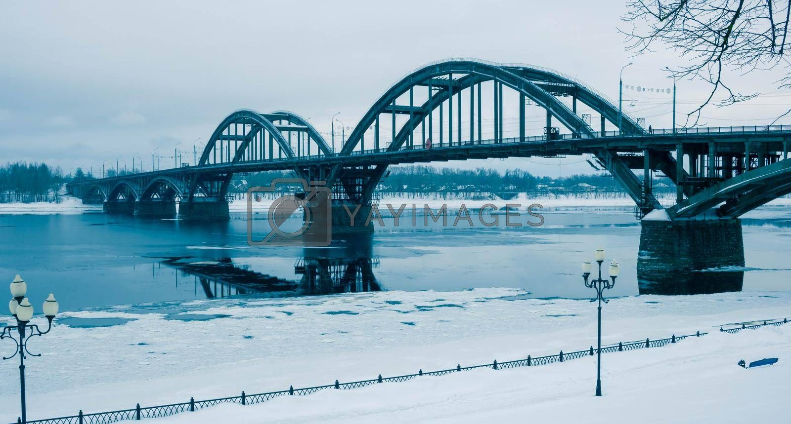 Ice floats on the Volga River.Automobile bridge in the city of Rybinsk, Russia.