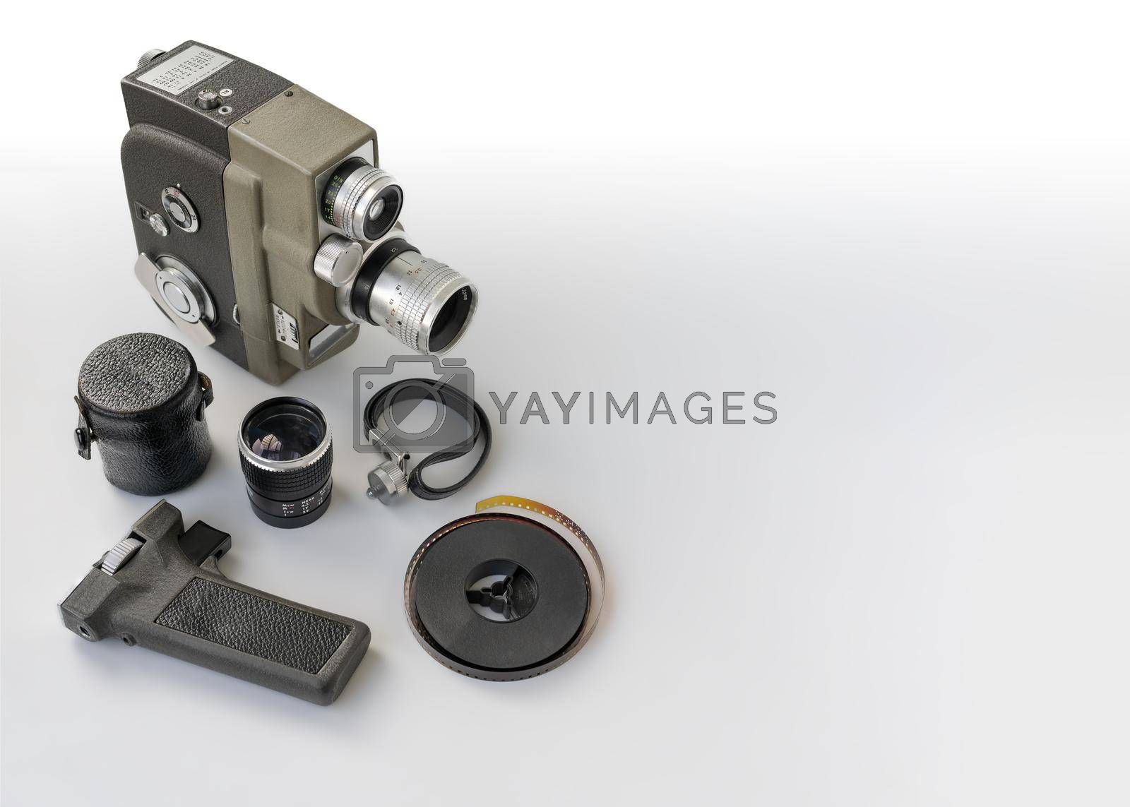 Royalty free image of Vintage 8mm camera with 8mm reel and accessories. by maramade